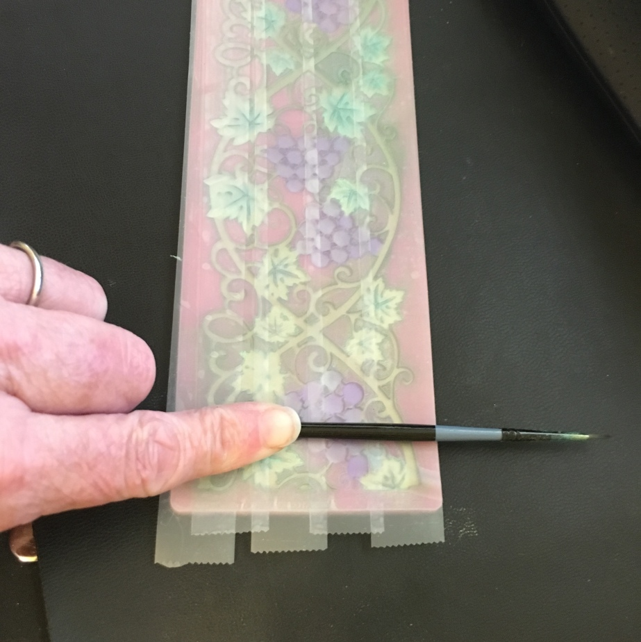 rubbing tape to pull off excess mica on top